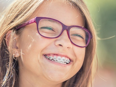 Preteen girl with metal braces